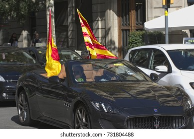 BARCELONA, SPAIN – OCTOBER 8, 2017: Car with Spanish and Catalan Flags in support for the demonstration for the Spanish unity, against Catalonia Independence vote.