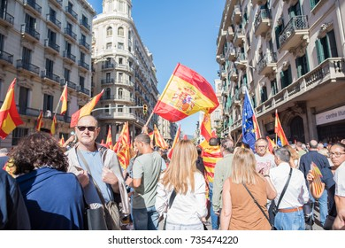 Barcelona, Spain, October 8, 2017: A man in focus amidst a huge crowd during a pro-unity rally in Barcelona's Gothic Quarter. Hundreds of thousands participated, supporting remaining part of Spain
