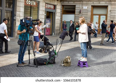 Barcelona, Spain - October 9, 2017: cameraman and the TV host, film crew  in coverage of political events in European city