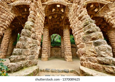 Barcelona, Spain. Park Guell.  Entrance structures with stone pillars and archs. Famous touristic destination landmark for walking tours.