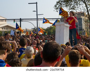 BARCELONA, SPAIN - SEPT. 11: Carme Forcadell, President of ANC talks in the center scenario of rally for the independence during the National Day of Catalonia on Sept. 11, 2014 in Barcelona, Spain.
