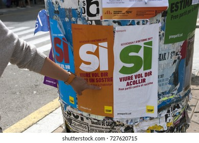 BARCELONA, SPAIN - SEPTEMBER 07, 2017. Catalan nationalists are hanging propaganda about Catalan Referendum on the streets Sant Boi de Llobregat Barcelona province in Catalonia, Spain
