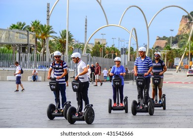 BARCELONA, SPAIN - SEPTEMBER 08, 2015: Tourist sightseeing on Segway tour of Barcelona in the seafront. Barcelona is the world's fourth most visited tourist destination.