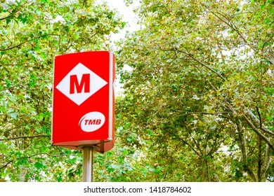 Barcelona, Spain - September 08, 2018: Trees and subway sign in the Rambla in summer in Barcelona, Spain