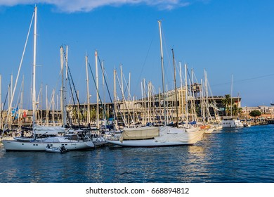 BARCELONA, SPAIN - SEPTEMBER 10, 2016: Yachts and sailing boats in Port Vell (Old Harbour). Port Vell and Rambla de Mar - one of main attractions in Barcelona.