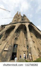 BARCELONA, SPAIN - SEPTEMBER 10: Entrance of La Sagrada Familia - the impressive cathedral designed by Gaudi, is being build since 1882 and is not finished yet September 10, 2012 in Barcelona, Spain.