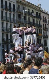 Barcelona, Spain - September 11, 2014: Castellers (human castles) performing at National Day in Barcelona, Spain