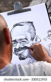 BARCELONA, SPAIN - SEPTEMBER 11, 2015: The rambla street in Barcelona is popular for their artist like the caricaturist drawing people with different styles.