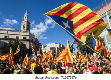 Barcelona, Spain - September 11, 2017: Catalans waving Estelada flags during march for independence on September 11, 2017 in Barcelona, Spain.