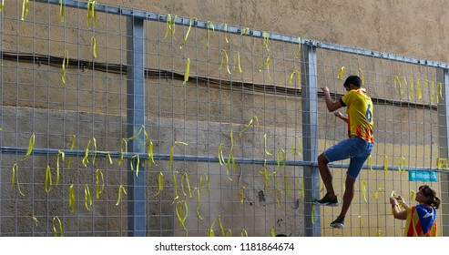 Barcelona, Spain - September 11, 2018: Yellow ribbons to protest supporting the Catalan Government jailed since months seen attached during the Diada, a yearly Catalan Nationalism celebration.