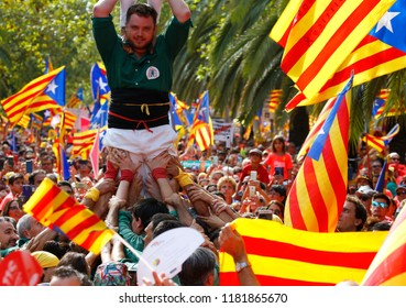 Barcelona, Spain - September 11, 2018: Citizens coming from all around Catalonia celebrate in Barcelona wearing catalan flags known as estelada, their Diada, a yearly Catalan Nationalism celebration.
