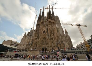 "Barcelona, Spain, september 12, 2018: Turists visit the ""Sagrada Familia"". This impressive cathedral was originally designed by Antoni Gaudi. Barcelona, Spain, september 12, 2018"