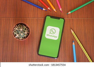 Barcelona, Spain - September 12, 2020; Whatsapp Iphone Screen with Colored Pencils and Succulent Plant. WhatsApp Messenger is a freeware, cross-platform messaging and VoIP service.