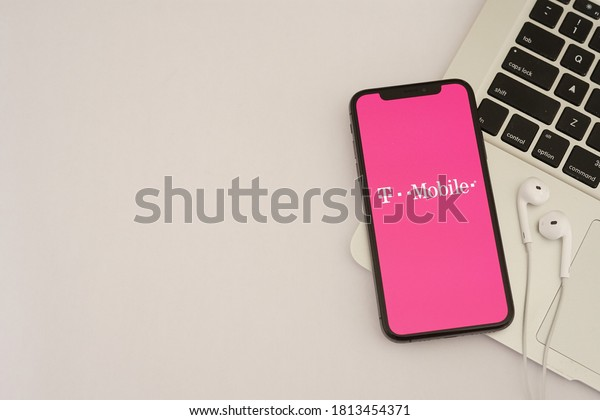 Barcelona, Spain - September 12, 2020; TMobile App with Macbook and Earphone. T-Mobile is a mobile communications company. #T-Mobile