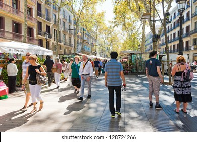 BARCELONA, SPAIN - SEPTEMBER 14: La Rambla on September 14, 2012 in Barcelona, Spain. Thousands of people walk daily by this popular pedestrian area 1.2 kilometer-long