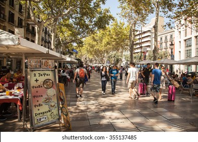 BARCELONA, SPAIN - SEPTEMBER 14: La Rambla on September 14, 2015 in Barcelona, Spain. Thousands of people walk daily by this popular pedestrian area 1.2 kilometer-long.