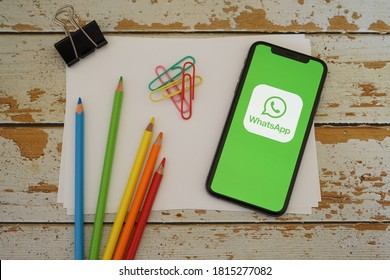 Barcelona, Spain - September 15, 2020; Whatsapp Iphone Screen with Colored Pencils and Stationery. WhatsApp Messenger is a freeware, cross-platform messaging and VoIP service. #WhatsApp Messenger