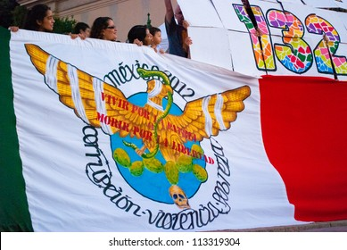 BARCELONA, SPAIN. SEPTEMBER 15TH: Unidentified Mexicans from #YoSoy132  protest against the electoral fraud in Mexico, on 15/Sept/2012 in Barcelona during the ceremony of the mexican independence day.