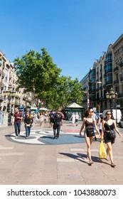 BARCELONA, SPAIN - SEPTEMBER 2: Joan Miro's Pla de l'Os mosaic in La Rambla on September 2, 2017 in Barcelona, Spain. Thousands of people walk daily on the mosaic, designed by famous artist Joan Miro