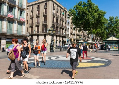 BARCELONA, SPAIN - SEPTEMBER 2: Joan Miro's Pla de l'Os mosaic in La Rambla on September 2, 2017 in Barcelona, Spain. Thousands of people walk daily on the mosaic, designed by famous artist Joan Miro