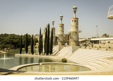 BARCELONA, SPAIN - SEPTEMBER 2: Park of industrial Spain. The park was built in 1985 on top of an old textile factory. In background, Sants station. Image with vintage and yesteryear effect