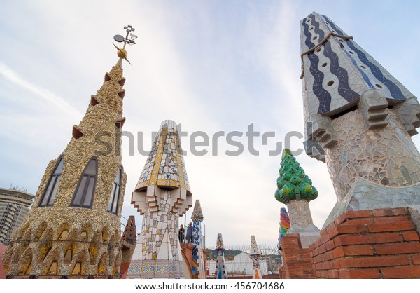 BARCELONA, SPAIN - SEPTEMBER 20, 2014: Design of the roof of Palace Guell (Palau Guell) - Gaudi Chimney: broken tile mosaics and strange decorated chimneys are evident in his early work.