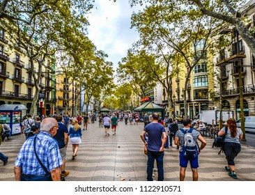 Barcelona, Spain - September 20 2016: Tourists and local Spaniards shop and dine as they walk the famous La Rambla in Barcelona Spain
