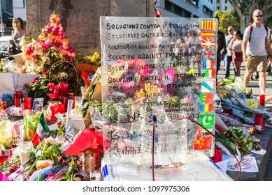 Barcelona, Spain - September 20, 2017: Candles, flowers with a text in several languages in Catalunya square by the Barcelona bombing occurred in Les Rambles  in Barcelona, Catalonia, Spain