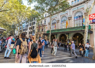 Barcelona, Spain - September 20, 2017: People walking along Les Rambles with the Liceo Theater in the background in Barcelona, Catalonia, Spain