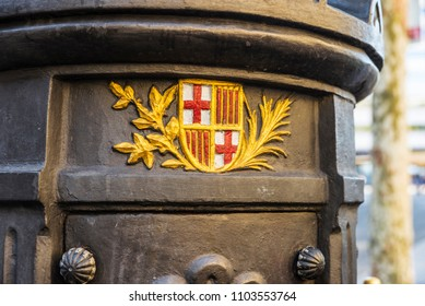 Barcelona, Spain - September 20, 2017: Shield of Barcelona in the Font de Canaletes, ornate fountain crowned by a lamp post, in Les Rambles of Barcelona, Catalonia, Spain
