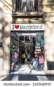 Barcelona, Spain - September 20, 2017: Souvenir shop with people around in Les Rambles of Barcelona, Catalonia, Spain