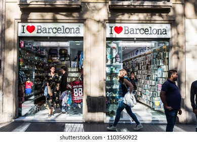 Barcelona, Spain - September 20, 2017: Souvenir shop with people walking around in Les Rambles of Barcelona, Catalonia, Spain