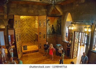 BARCELONA, SPAIN - SEPTEMBER 2018: Tourists and visitors walk inside the Palau Guell palace designed by Antonio Gaudi in Barcelona.