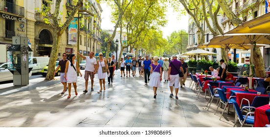 BARCELONA, SPAIN - SEPTEMBER 21: La Rambla on September 21, 2012 in Barcelona, Spain. Thousands of people walk daily by this popular pedestrian area 1.2 kilometer-long