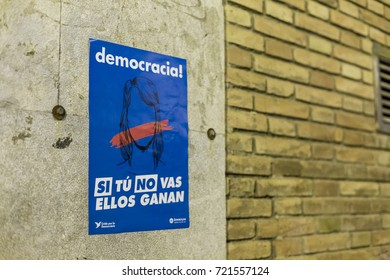BARCELONA, SPAIN - SEPTEMBER 22, 2017. Catalan nationalists are hanging propaganda about Catalan Referendum on the streets of Barcelona on September 22, 2017