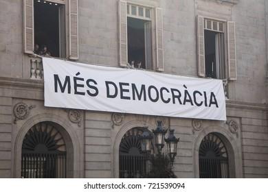 "Barcelona, Spain - September 24, 2017  Banner claiming ""more democracy"" in La Merce festivities at Sant Jaume Square, Barcelona."