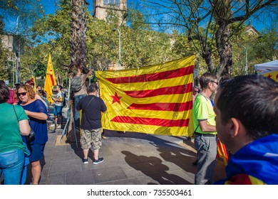 BARCELONA, SPAIN - SEPTEMBER 24, 2017: Hanging la Estrelada Vermella at the large peaceful pro-catalan demonstration gathering in the  Plaça de la Universitat in Barcelona.