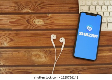 Barcelona, Spain - September 24, 2020; Shazam Apps with Earpiece and White Keyboard. Shazam is an application that can identify music. #Shazam