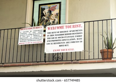 Barcelona, Spain - September 25, 2016: Board hanging on a balcony made by neighbours of Barceloneta hood in Barcelona, complaining of holiday apartments and turism's overpopulating in Barcelona