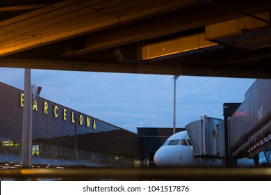 Barcelona, Spain - September 25, 2017; Glass facade and airplane as seen through the boarding area of Barcelona Airport, the main airport of Catalonia, Spain.