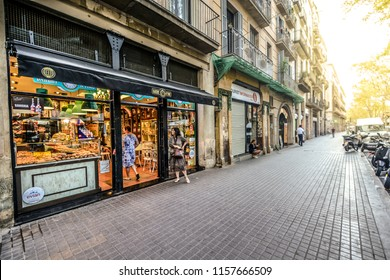 Barcelona, Spain - September 25 2017: Tourists and local Catalunyans visit a sandwich shop cafe in the early morning before the crowds on La Rambla in Barcelona Spain.