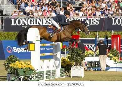 BARCELONA, SPAIN - SEPTEMBER 25: Malin Baryard Johnsson from Sweden rides horse H&M Tornesch at the 100th CSIO event at the Real Club de Polo Barcelona, on September 25, 2011, in Barcelona, Spain.