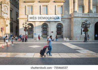 BARCELONA, SPAIN - SEPTEMBER 27, 2017: The plaza outside Barcelona City Hall where the sign calling for more democracy will later spark massive outrage when anti-separatists attempt to tear it down.