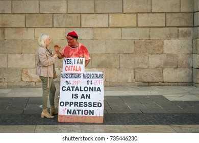 BARCELONA, SPAIN - SEPTEMBER 27: Political discussion between a demonstrator and interested party in the plaza outside Barcelona City Hall.