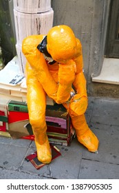 Barcelona, Spain - August 20, 2015: the thinker sculpture, as part of the Gracia Festival (Festes de Gracia) where there is a contest for the best garnished street.