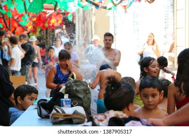 Barcelona, Spain - August 20, 2015: Water Fight for Kids as part of the Gracia Festival (Festes de Gracia) where there is a contest for the best garnished street.