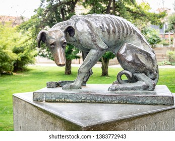 BARCELONA, SPAIN-APRIL 28, 2019: The abandoned dog (El perro abandonado) statue by Artur Aldoma Puig in the city Zoo