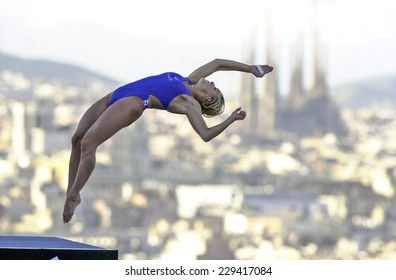 BARCELONA, SPAIN-JULY 16, 2003: italian Tania Cagnotto in action during the final of the Swimming World Championship, with the Gaudi cathedral in the back, in Barcelona.