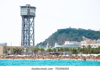 Barcelona, Spain-July 20: The Barceloneta beach with Barcelona's aerial cableway, crowd of people on the beach on July 29, 2012 in Catalonia.