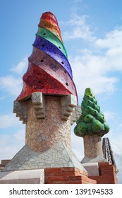 BARCELONA, SPAIN-MAY 12. The colorful mosaics chimneys made by broken ceramic tiles on the roof of Palau Guell. The palace is one of the earliest Gaudi's masterpiece. 12 May 2013. Barcelona, Spain